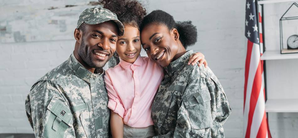 Small military family smiling in classroom