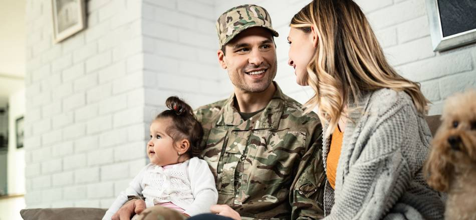 Small military family with baby and puppy