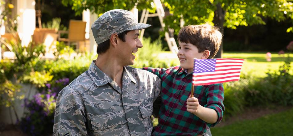 Military father with son holding small US flag